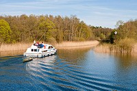 Houseboat on the waterway from lake Grosser Zechliner See to the Huetten kanal, near Zechlinerhuette, North Brandenburg Lake District, Brandenburg, Ge...