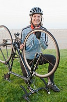 Caucasian woman fixing bicycle