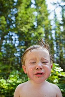 Boy crying outdoors