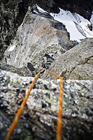 Abseiling from mount Grosslitzner, Silvretta mountain range, Vorarlberg, Austria