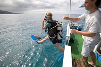 Diver jumping off the boat of Les Heures Saines Diving School, Bouillante, Basse_Terre, Guadeloupe, Caribbean Sea, America