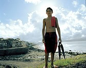 Boy at the city beach in Ribeira Grande, northern shore of Sao Miguel island, Azores, Portugal