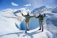 Tour guides in front of an ice cave, ice trekking, Perito Moreno glacier, Lago Argentino, Los Glaciares National Park, near El Calafate, Patagonia, Ar...