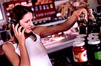 Woman Using Cellular Telephone While Shopping