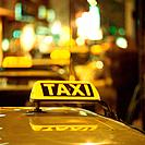 Illuminated taxis at night