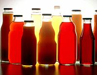 Different bottles filled with fruit juice