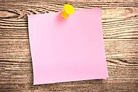 Pink paper note on wood, clipping path