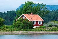 Small, red house by the sea