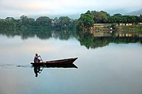 Nepalese fisherman on boat on Phewa lake, Pokhara, Nepal
