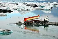 Truck building antierosion breakwater wall in famous Glacial lagoon Jokullsarlon, Iceland