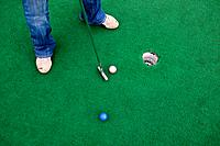Putting on Miniature Golf Course