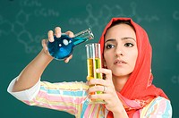 Teacher holding measuring tubes, close_up