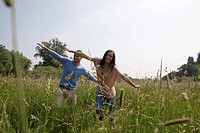 Enthusiastic young couple in field