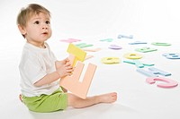baby boy playing with letters