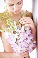 woman holding bunch of orchid