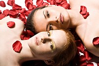 two women in roses patals