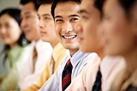 Smiling Businessman in Group