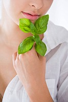 young woman with fresh basil
