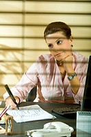 Woman dreaming in office