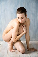 nude woman covering her body