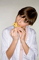 young woman with fries in mouth