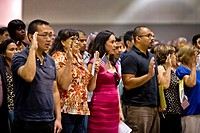 Immigrants of many ages and nationalities take the oath of United States citizenship in Los Angeles
