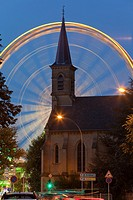church and Ferris wheel at night, Luxembourg
