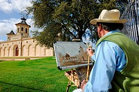 Painter working in front of Cos d'Estournel castel in Bordeaux region, Aquitaine, Gironde, France