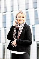 portrait of telephoning young businesswoman