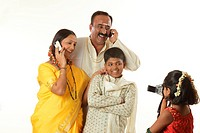 South Indian daughter photographing parents and brother talking on mobile phones in video camera MR748S,748T,748U,748V