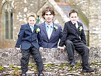 Man with two boys outside church