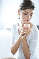 young woman holding cream