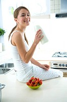 woman drinking milk in kitchen
