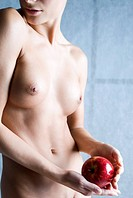 nude woman with red apple