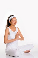 Teenage girl sitting in meditation posture joint hand palm MR686M 12_July_2010
