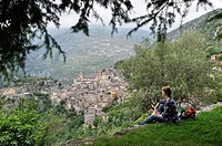 young woman admiring the perched village of Saorge, Mercantour National Park, Alpes-Maritimes department, Provence-Alpes-Cote d´Azur region, southeast...