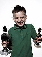 Boy Holding Two Trophies