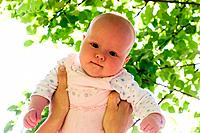 Baby against sunny leaves