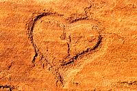 Heart scraped into sandstone