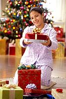 Girl in Pajamas Presenting Christmas Gift