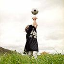 Small Boy Playing with Soccer Ball