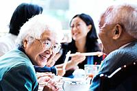 Elderly Couple at Restaurant with Family