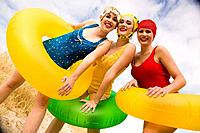 Friends in Retro Swimwear With Inner tubes