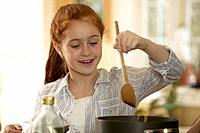 Girl Cooking Spaghetti Noodles