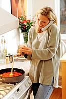 Woman Cooking and Talking on Phone