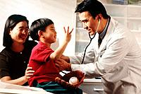 Doctor examining a little boy