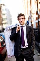 A businessman carrying his dry cleaning (thumbnail)