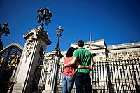 A young couple standing in front of Buckingham Palace, rear view (thumbnail)