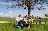 Family Having Picnic at aTree, Germany, Bavaria