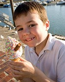 A boy eating an ice cream